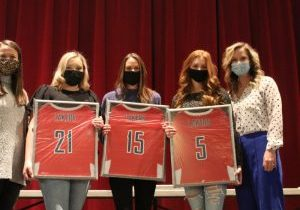 Seniors Ashton Baird, Abby Loy, and Kylee Roy with their jerseys