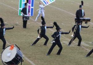 The band performs body movement during a percussion feature.